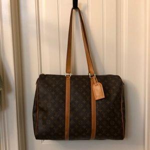 Louis Vuitton large bag.